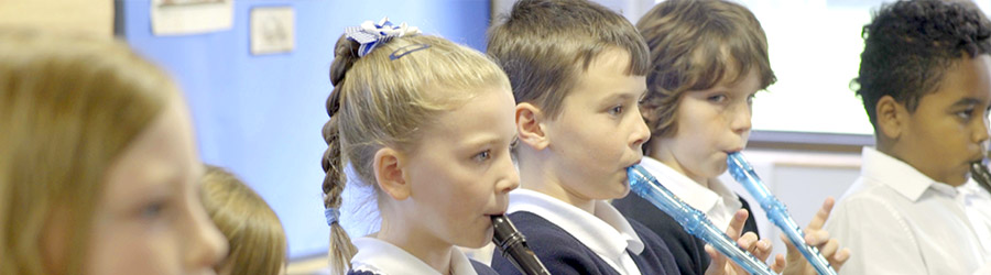 Children playing recorder